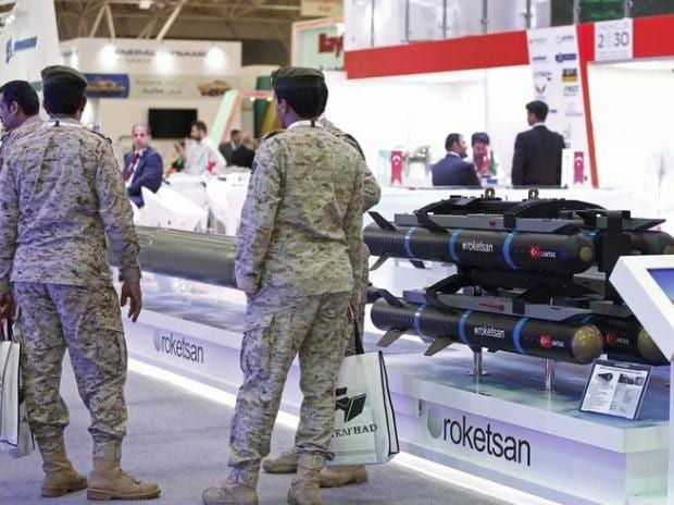 Soldiers stand beside a missile display at the Armed Forces Exhibition for Diversity of Requirements and Capabilities (AFED) in Riyadh. (Photo: Bloomberg)