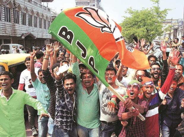BJP supporters celebrating the party's win in Agartala on Saturday. The BJP ended 25 years of  CPI(M) rule in Tripura Photo: PTI