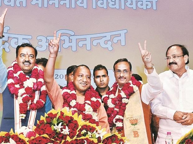 CM Yogi Adityanath with his deputies K P Maurya, left, and Dinesh Sharma, right. They have to ensure the BJP's popularity till 2019