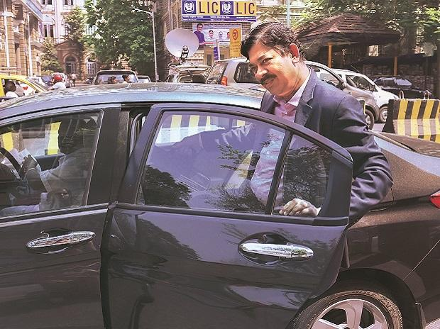 Axis Bank Deputy Managing Director V Srinivasan leaves after appearing before the SFIO in Mumbai on Tuesday. Photo: PTI