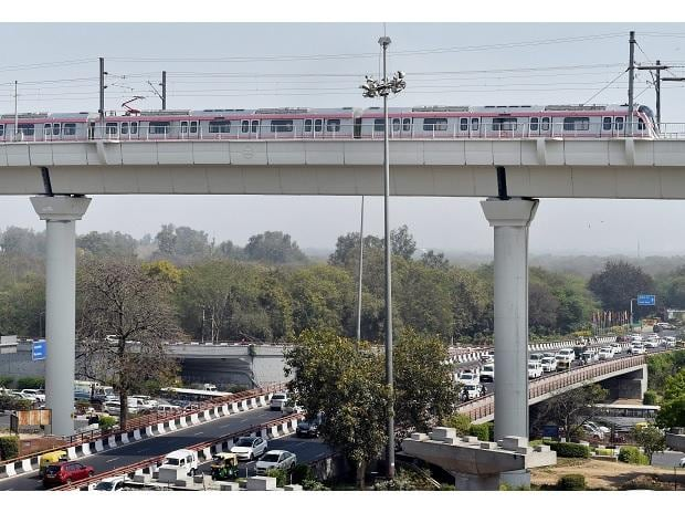 A Metro train moves across the new Majlis Park and Durgabai Deshmukh South Campus Metro section during a media preview in New Delhi, on Monday. Majlis Park-Shiv Vihar corridor (Line 7) of the metro network, also known as the Pink Line. (Photo: PTI)