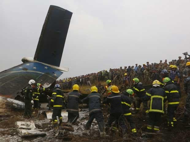 Kathmandu: Nepalese rescuers work after a passenger plane from Bangladesh crashed at the airport in Kathmandu, Nepal