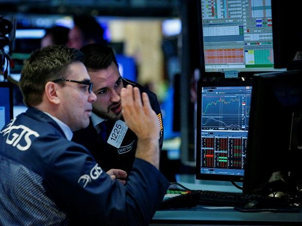 USA stocks end higher on upbeat data; major indexes post weekly losses