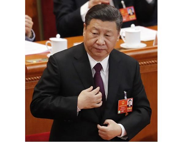 Chinese President Xi Jinping stands for the national anthem during the closing session of the annual National People's Congress (NPC) at the Great Hall of the People in Beijing. (Photo: AP/PTI)