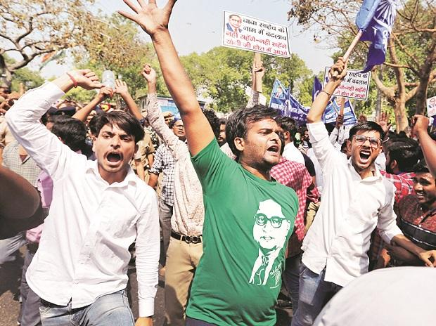 Delhi: People belonging to the Dalit community shout slogans as they take part in the strike