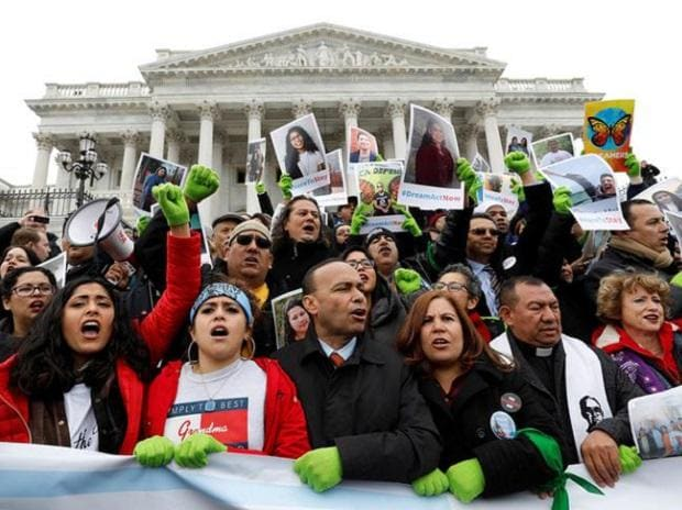DREAM ON: Supporters of the Dreamers rally on the steps of the Senate in Washington