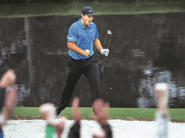 Patrick Reed of the US celebrates chipping in for an eagle on the 15th hole during third round play of the 2018 Masters golf tournament at the Augusta National Golf Club in Augusta, Georgia, on Saturday. Photo: Reuters