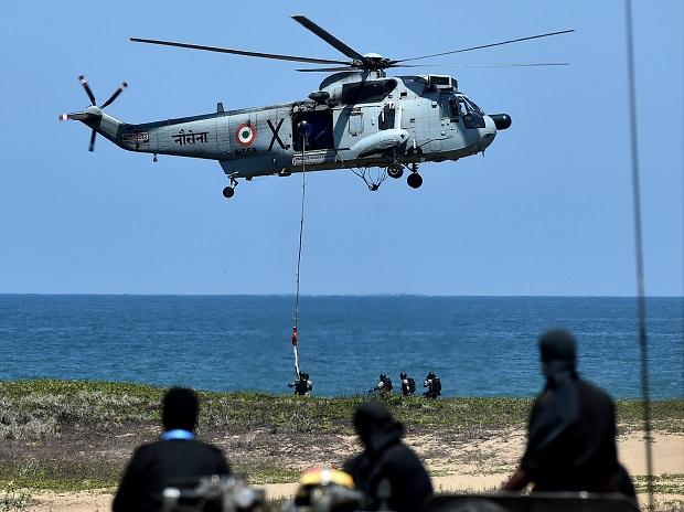 A soldier is airdropped on the beaches of Chennai