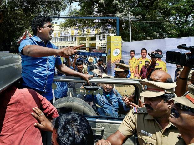 Police detain activists of  Tamizhaga Vazhvurimai Katchi who were staging an anti-IPL protest outside MAC Stadium in Chennai on Tuesday. Photo: PTI