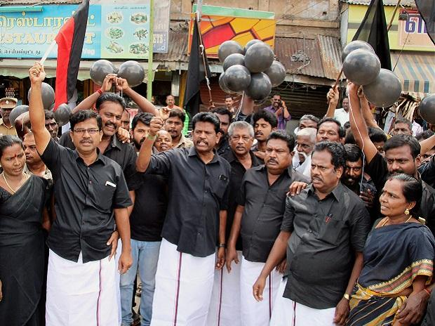 DMK cadres release black balloons as they stage a protest against Prime Minister Narendra Modi's visit, in Madurai on Thursday