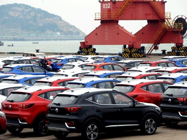 Sports utility vehicles (SUVs) waiting to be exported are seen at a port in Lianyungang, Jiangsu province, China April 5, 2018