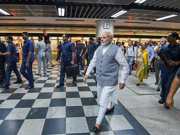 Prime Minister Narendra Modi at a Delhi Metro station before a ride on his way to inaugurate Ambedkar National Memorial at 26 Alipur Road, Delhi Friday