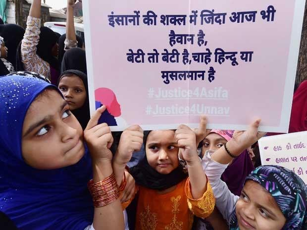 School and Madarsa students display placards as they protest over government's alleged 'inaction' in Kathua and Unnao rape cases, in Ahmedabad on Sunday