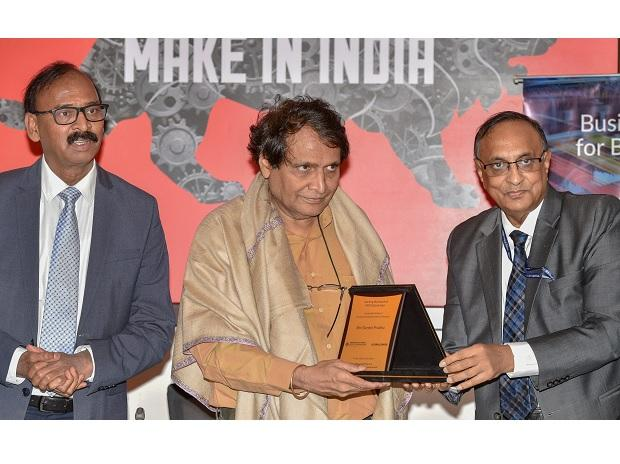 Union Minster of Commerce and Industry & Aviation Suresh Prabhu being presented a memento by President FIEO Ganesh Kumar Gupta during the launch of FIEO GlobaiLinker, a digital platform for MSMEs to facilitate and promote exports, in New Delhi. Photo