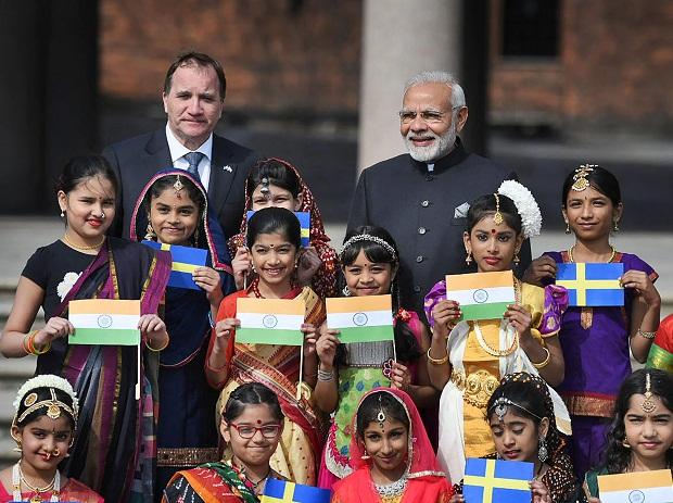 Prime Minister Narendra Modi and the Prime Minister of Sweden, Stefan Lofven with the children in traditional Indian costumes, at City Hall in Stockholm, Sweden on Tuesday