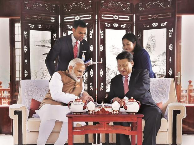 Prime Minister Narendra Modi with Chinese President Xi Jinping inside a house boat in Wuhan, China. (Photo: PTI)