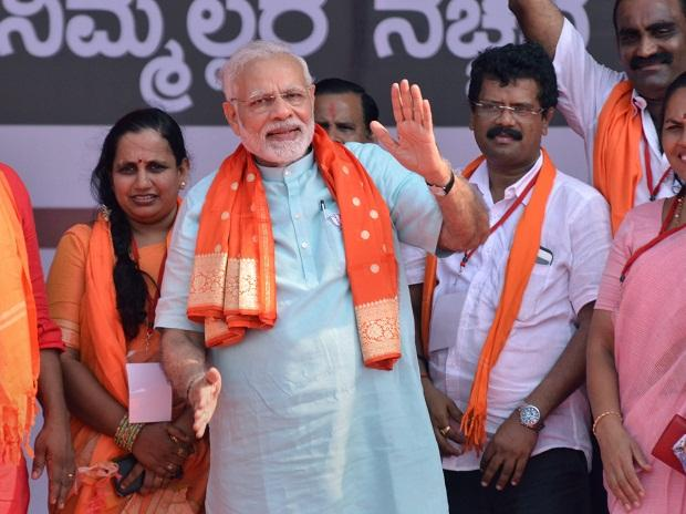 Prime Minister Narendra Modi with BJP workers at an election campaign rally, ahead of Karnataka polls, in Udupi on Tuesday. PTI Photo