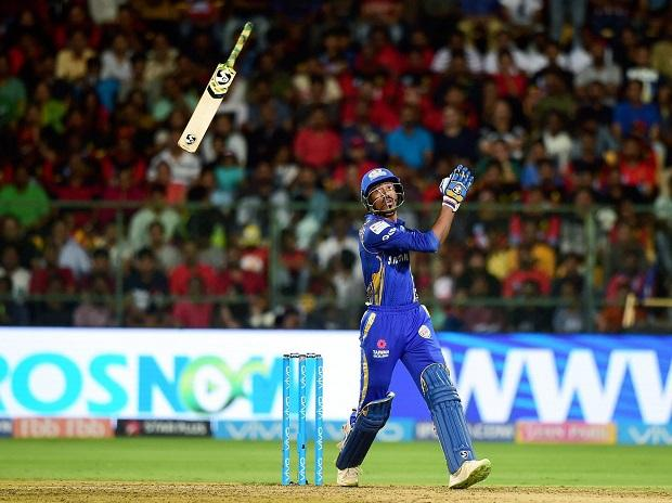 Mumbai Indians' Hardik Pandya bat slips from his hand against  Royal Challengers Bangalore during the IPL 2018 cricket match at Chinnaswamy Stadium in Bengaluru. Photo: PTI
