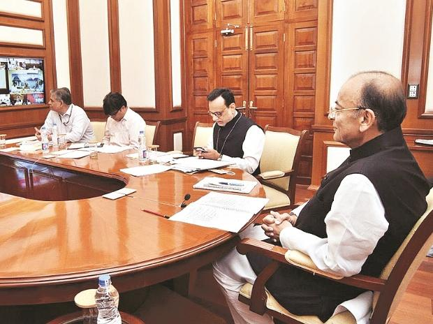 Finance Minister Arun Jaitley (right) during the GST Council meeting. (Photo: twitter)