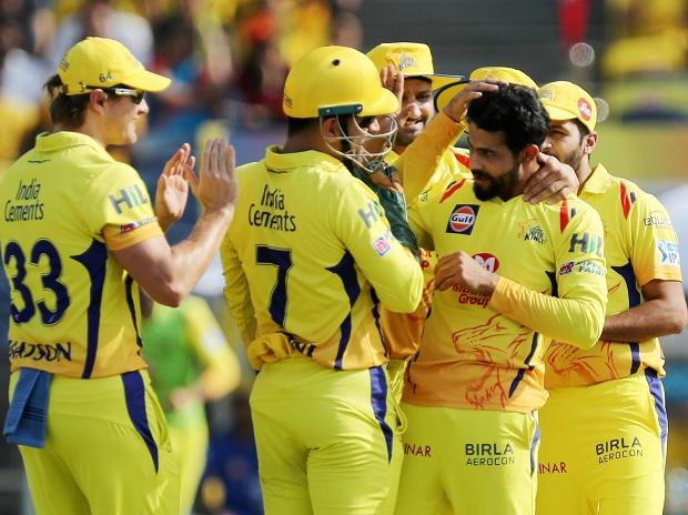 Chennai Super Kings' Ravindra Jadeja with his teammates celebrates the dismissal of Royal Challengers Bangalore's captain Virat Kohli during an IPL cricket match in Pune. Photo: PTI