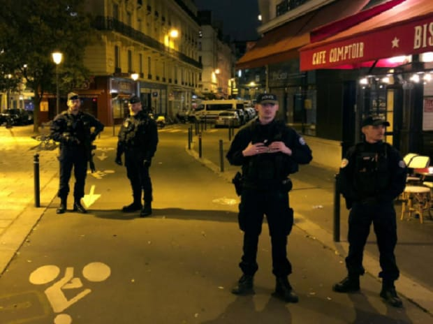 French police secure a street after a man killed a passer-by in a knife attack in the heart of Paris