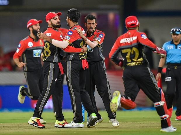 Royal Challengers Bangalore players celebrate the dismissal of Kings XI Pinjab's KL Rahul during an IPL cricket T20 match at Holkar Stadium in Indore. Photo: PTI