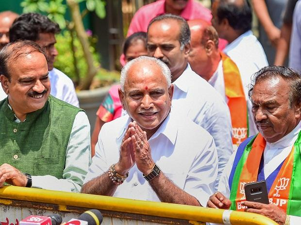 BJP legislature party leaders B S Yeddyurappa, accompanied by party leaders Ananth Kumar and K Eshwarappa, gestures while addressing the media after meeting with Governor Rudabhai Vajubhai Vala to stake claim for the formation of government, in Benga