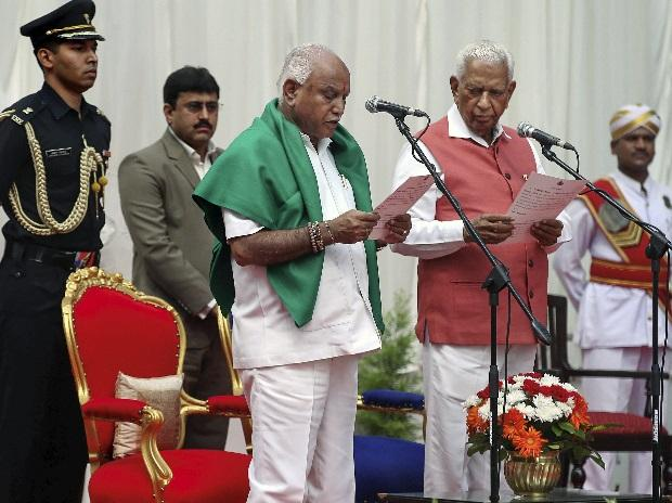 Karnataka Governor Vajubhai Vala administers oath to Bharatiya Janata Party (BJP) leader B S Yeddyurappa as Chief Minister of the state at a ceremony in Bengaluru. (Photo: PTI)
