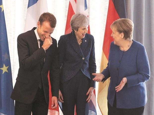 French President Emmanuel Macron with British PM Theresa May and German Chancellor Angela Merkel before the EU-Western Balkans Summit in Sofia on Thursday