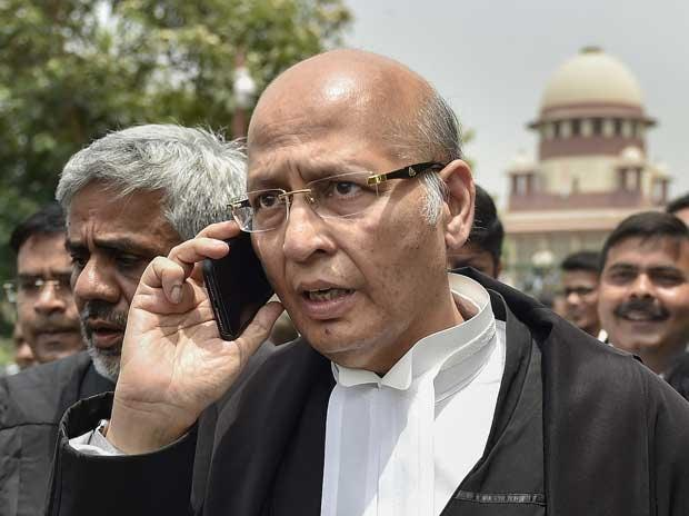 Senior Congress leader and Advocate Abhishek Singhvi leaves after a hearing in Karnataka government formation case, at Supreme Court in New Delhi