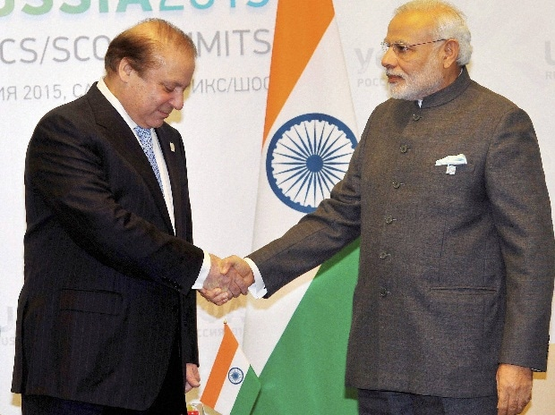 Prime Minister Narendra Modi and with his Pakistani counterpart Nawaz Sharif