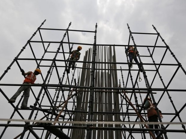 Workers erect scaffolding to build a pillar at the site of the metro railway flyover under construction in Ahmedabad (Pic: Reuters)