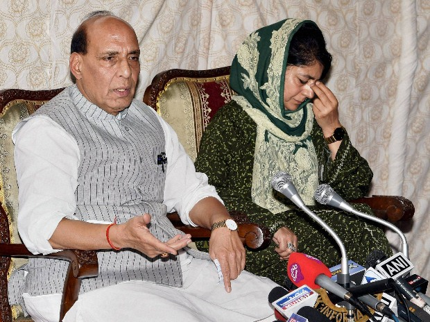 Union Home Minister Rajnath Singh and Jammu and Kashmir chief minister Mehbooba Mufti interact with media during a press conference in Srinagar