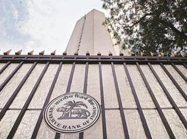 Hawkish RBI minutes rattle currency, gilts; rupee plunges to 13-month low