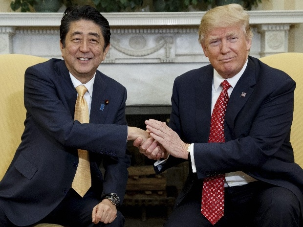 President Donald Trump shakes hands with Japanese Prime Minister Shinzo Abe in the Oval Office of the White House in Washington on Friday. <b>(Photo: PTI)