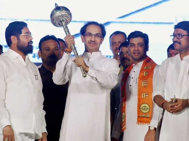 hiv Sena chief Uddhav Thackeray with party members at an election rally in Thane on Friday night.