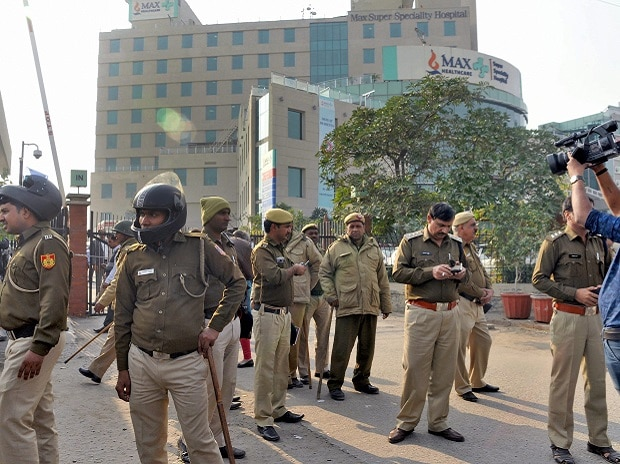 Police force deployed at out side the Max hospital, Shalimar Bagh where a newborn baby was declared dead,  who was found alive later, in New Delhi on Saturday. (Photo: PTI