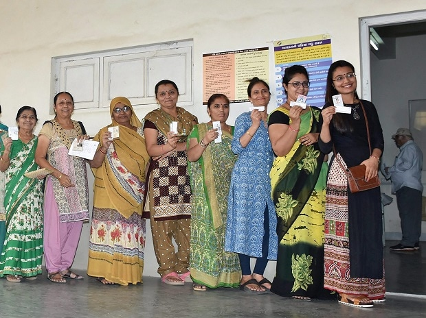 women line up to cast their ballot in Gujarat