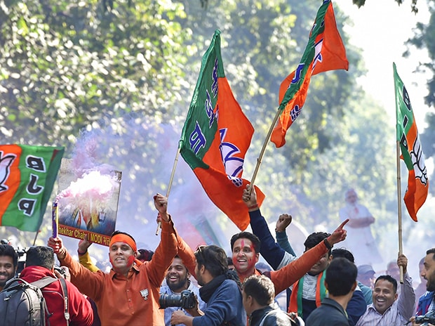 Party workers outside the BJP headquarter, in New Delhi