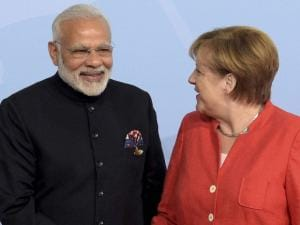 Narendra Modi, left, is welcomed by German Chancellor Angela Merkel on the first day of the G-20 summit