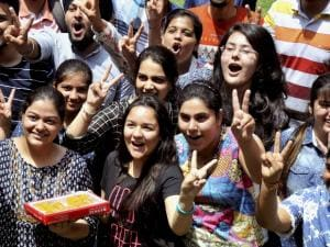 Students celebrate their success after the announcement of CBSE class