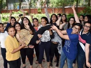 Students celebrate their success in CBSE class 12th examination at their school in New Delhi
