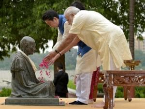 Prime Minister Narendra Modi and Japanese Prime Minister Shinzo Abe pay tributes to Mahatma Gandhi, at Gandhi Ashram in Ahmedabad on Wednesday
