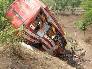 Police inspect near the ill-fated bus which met with an accident at Panvel on Mumbai-Pune expressway, in Mumbai