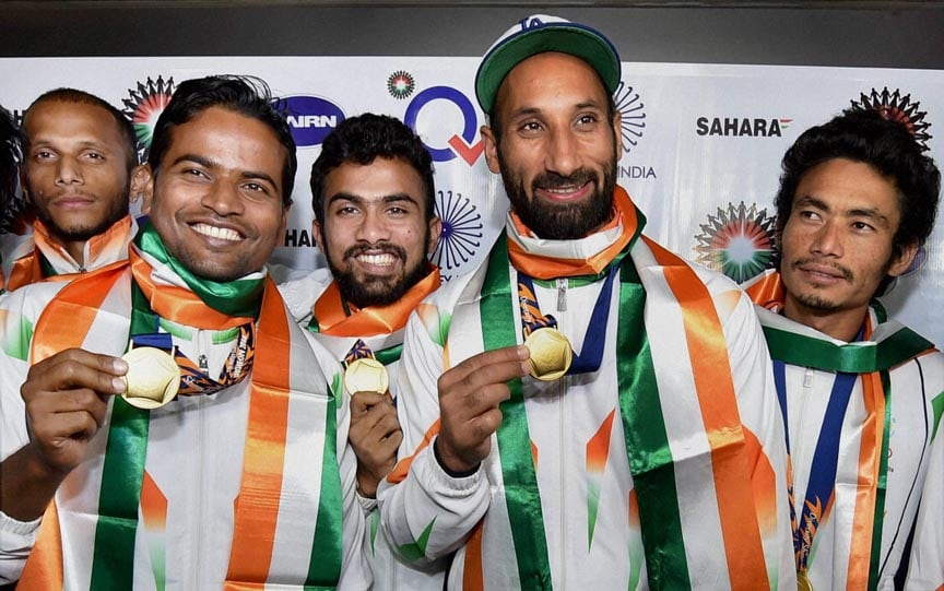 Players, Asian Games, gold medal, winner, Indian Hockey team, captain, Sardar Singh, pose, medals, IGI airport, New Delhi
