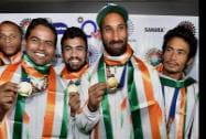 Players of the Asian Games gold medal winner Indian Hockey team with captain Sardar Singh