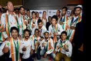 Players of the Asian Games gold medal winning Indian Hockey team jubilate