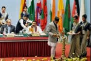 Nepalese Prime Minister Sushil Koirala lights the lamp at the inaugural session of the 18th SAARC Summit