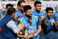 India's Suresh Raina being felicitated for his 200th International match