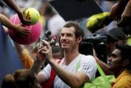 Andy Murray of the United Kingdom signs autographs after defeating Andrey Kuznetsov of Russia